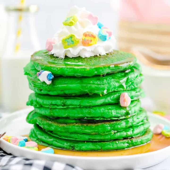 Stacked Green Pancakes with toppings square image