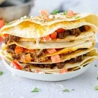 Plate of Taco Quesadillas on white plate uncut