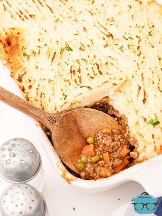 Serving spoon in casserole dish of The Best Shepherd's Pie