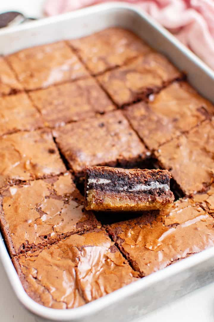 Cut Slutty Brownies in pan with one browning sticking up.
