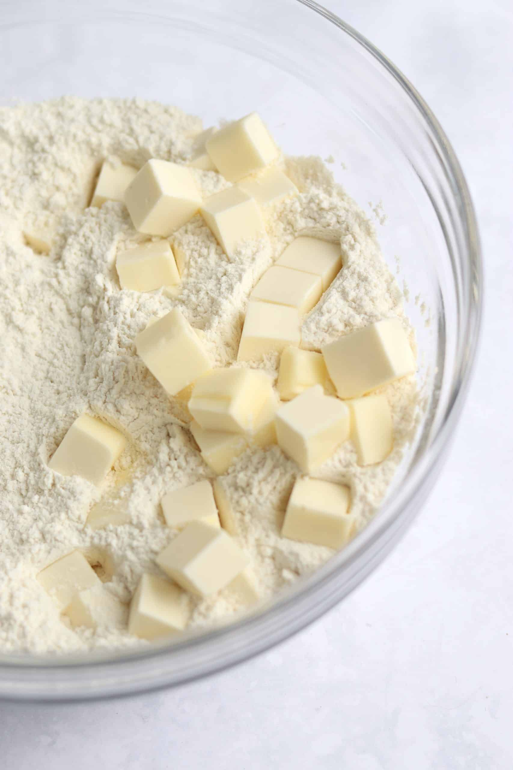 Cubed butter added to dry ingredients.