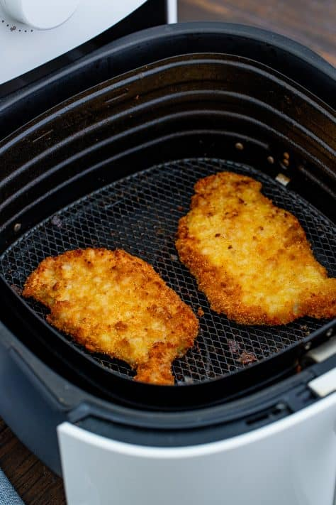 Two Air Fryer Pork Chops after frying in air fryer