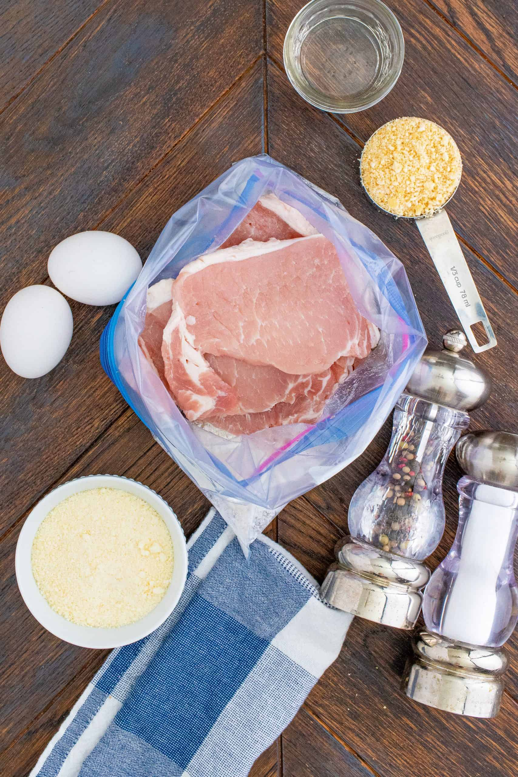 overhead photo of pork chops added to bag with flour mixture