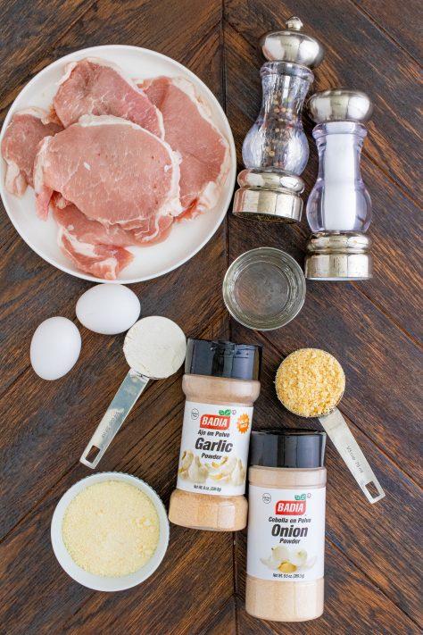 Ingredients needed to make Air Fryer Pork Chops: all-purpose flour, salt andpepper, thin-cut boneless pork chops, eggs, water, club crackers, parmesan cheese, garlic powder, onion powder