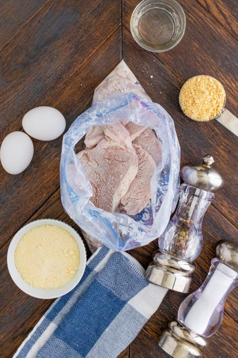 Coated pork chops in baggie with flour
