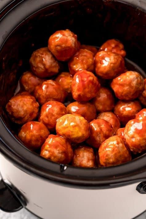 Finished meatballs in crock pot stirred up