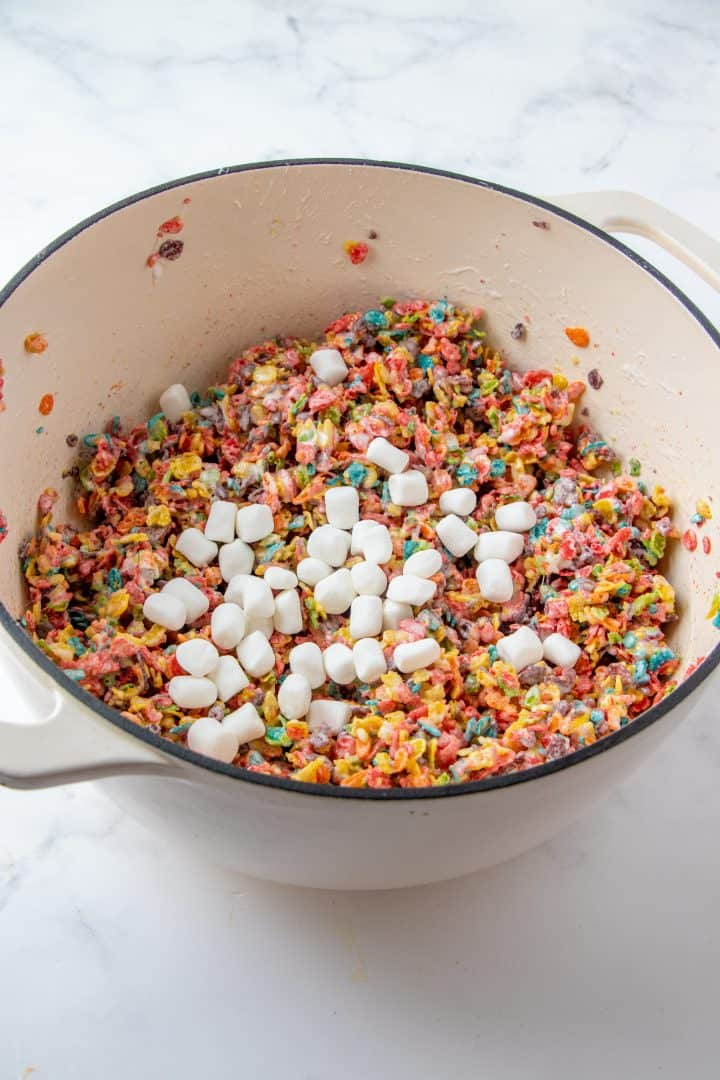 Whole marshmallows added to fruity pebble mixture
