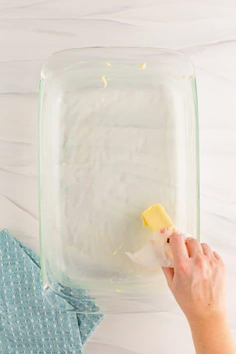 Hand buttering baking dish