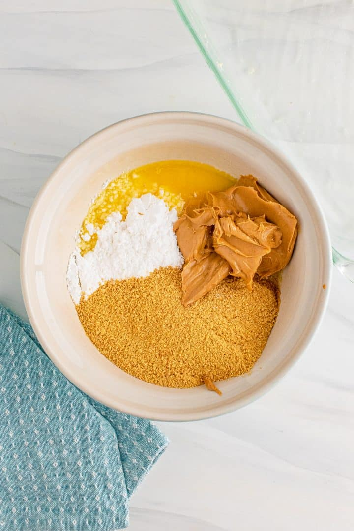 Graham cracker crumbs, peanut butter and powdered sugar.