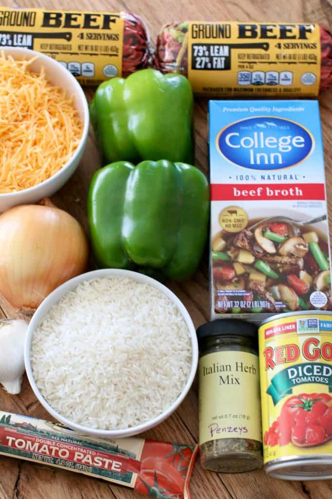 Stuffed Pepper ingredients: ground beef, green bell peppers, diced onion, garlic, salt & pepper, Italian seasoning, tomato paste, diced tomatoes, beef broth, long grain rice, sharp cheddar cheese
