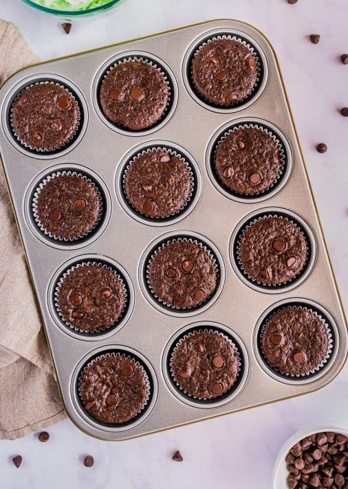 Baked cupcakes out of oven cooling in pan