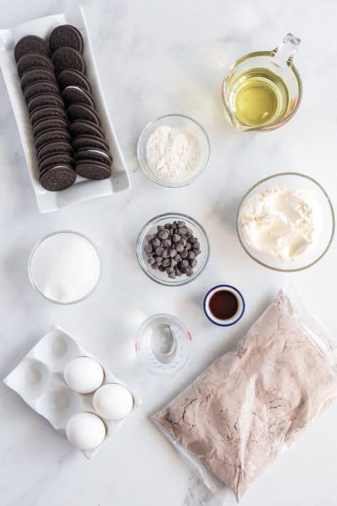Ingredients needed brownie mix, oreos, cream cheese, sugar, vanilla extract, egg, all-purpose flour and chocolate chips