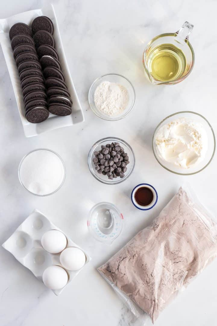 Ingredients needed brownie mix, oreos, cream cheese, sugar, vanilla extract, egg, all-purpose flour and chocolate chips.