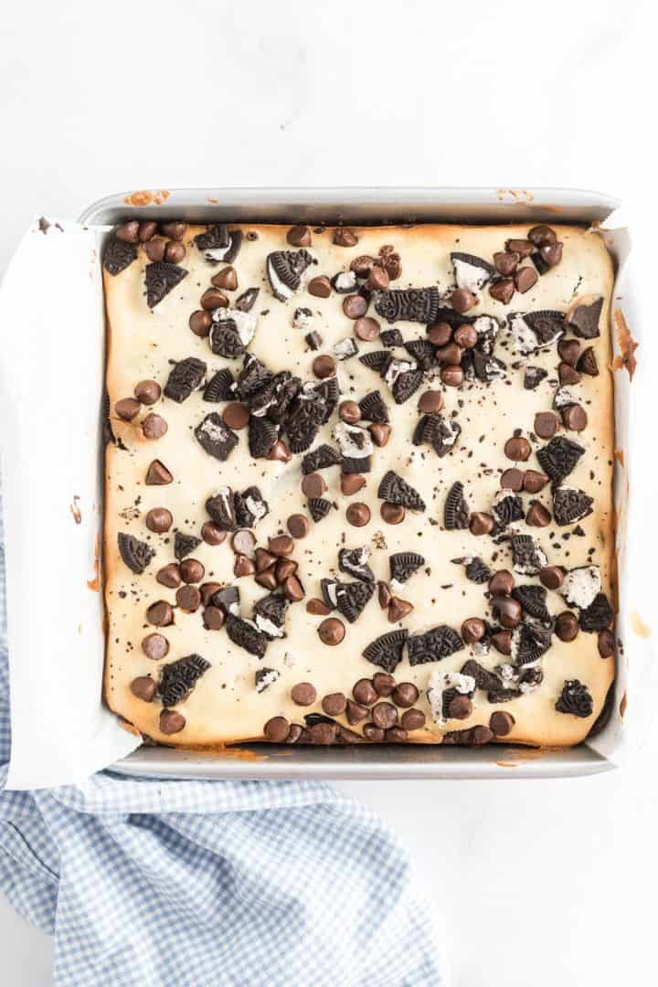 overhead photo of finished baked Oreo Cheesecake Brownies in metal baking pan.