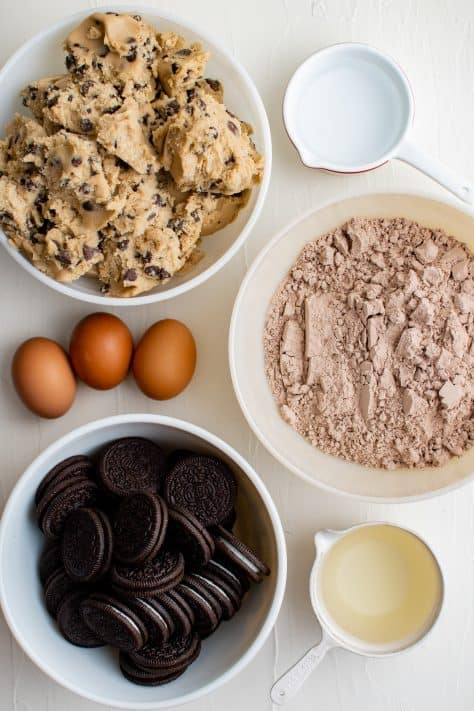 Ingredients needed brownie mix, chocolate chip cookie dough, oreo cookies, eggs, water and oil