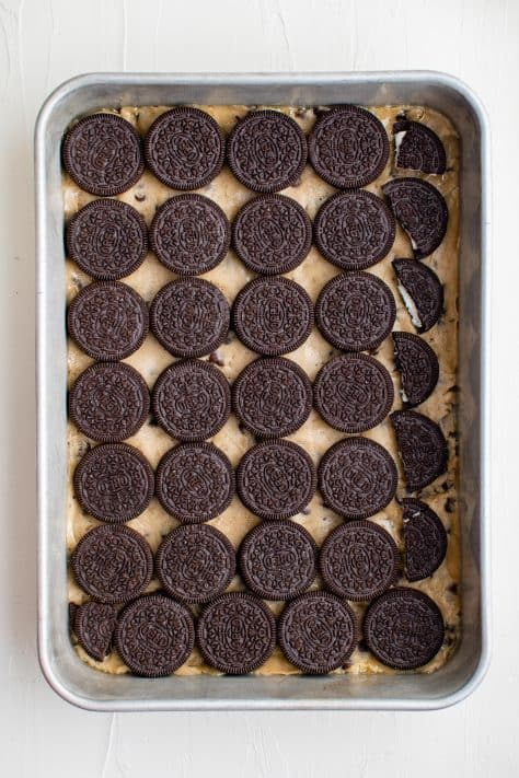 Oreos layered on top of cookie dough