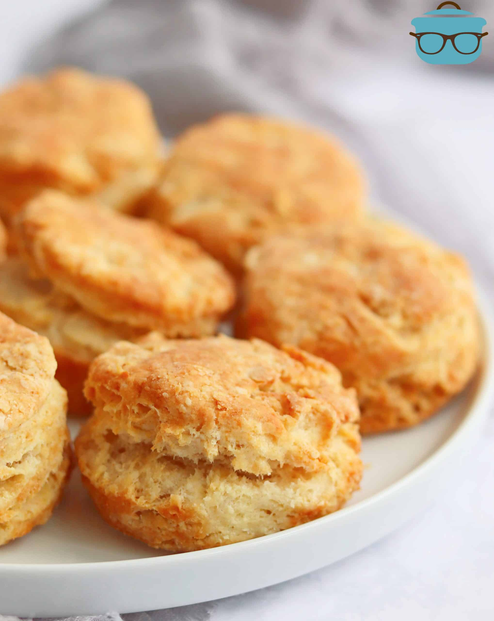 Close up of Air Fryer Buttermilk Biscuits on white plate.