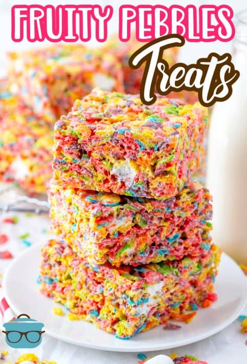 Stacked Fruity Pebbles Treats with more treats in background Pinterest image