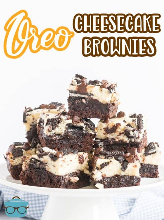 Stacked Oreo Cheesecake Brownies on stand Pinterest image