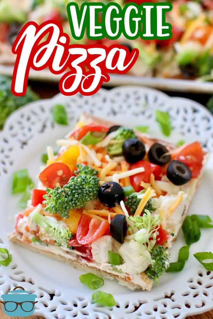 Easy Veggie Pizza recipe from The Country Cook, slice of pizza shown on a white plate