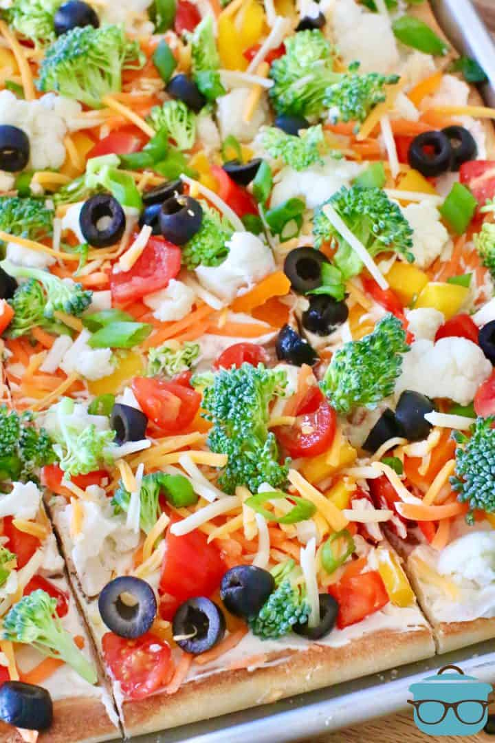Veggie Cream Cheese Pizza shown in slices on a baking sheet