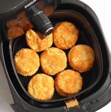 Square image of finished Air Fryer Buttermilk Biscuits in air fryer