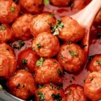 Close up of Crock Pot Meatloaf Meatball Recipe with serving spoon in crock pot
