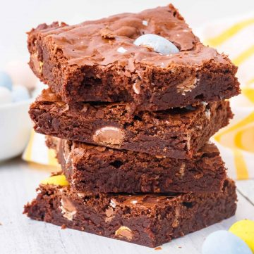 Close up of Stacked Easter Egg Brownies with bite take out of one square image