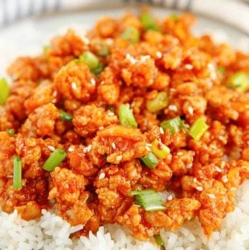 Close up of finished Orange Chicken on plate with rice square image