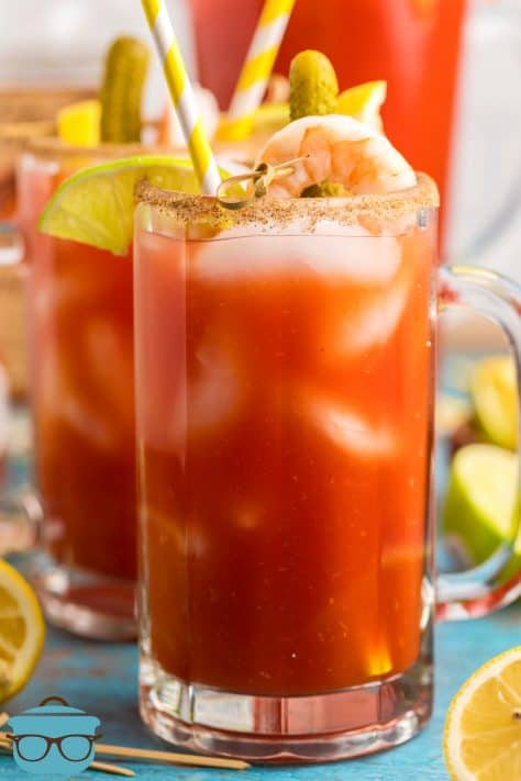 Bloody Mary Mix in tall glass with alcohol and garnishes