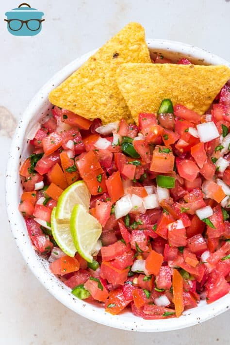 Overhead photo of Pico de Gallo in bowl with chips and lime