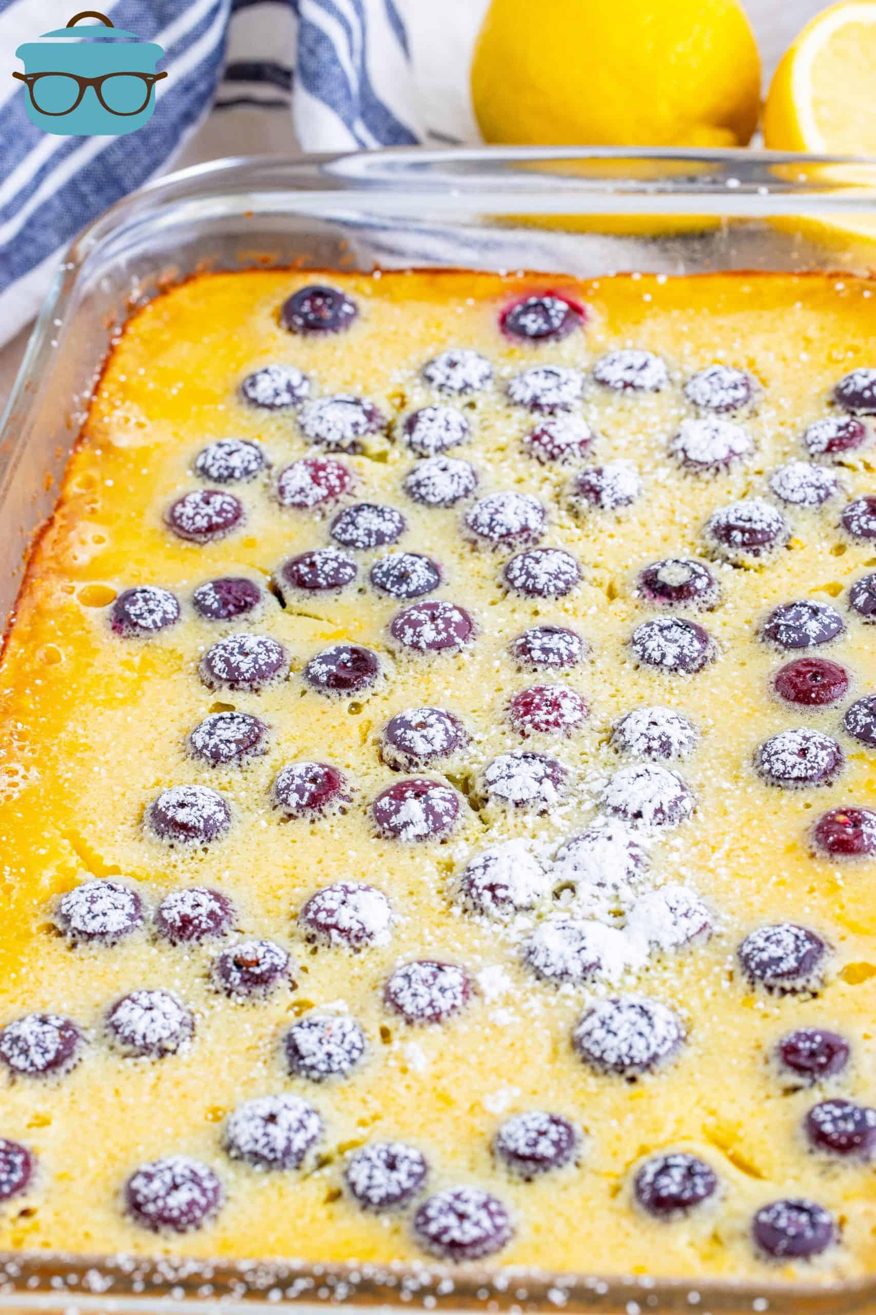 Baking dish with finished Blueberry Lemon Bars sprinkled with powdered sugar