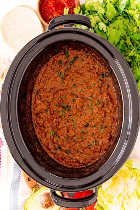 Finished Taco Meat in crock pot topped with cilantro