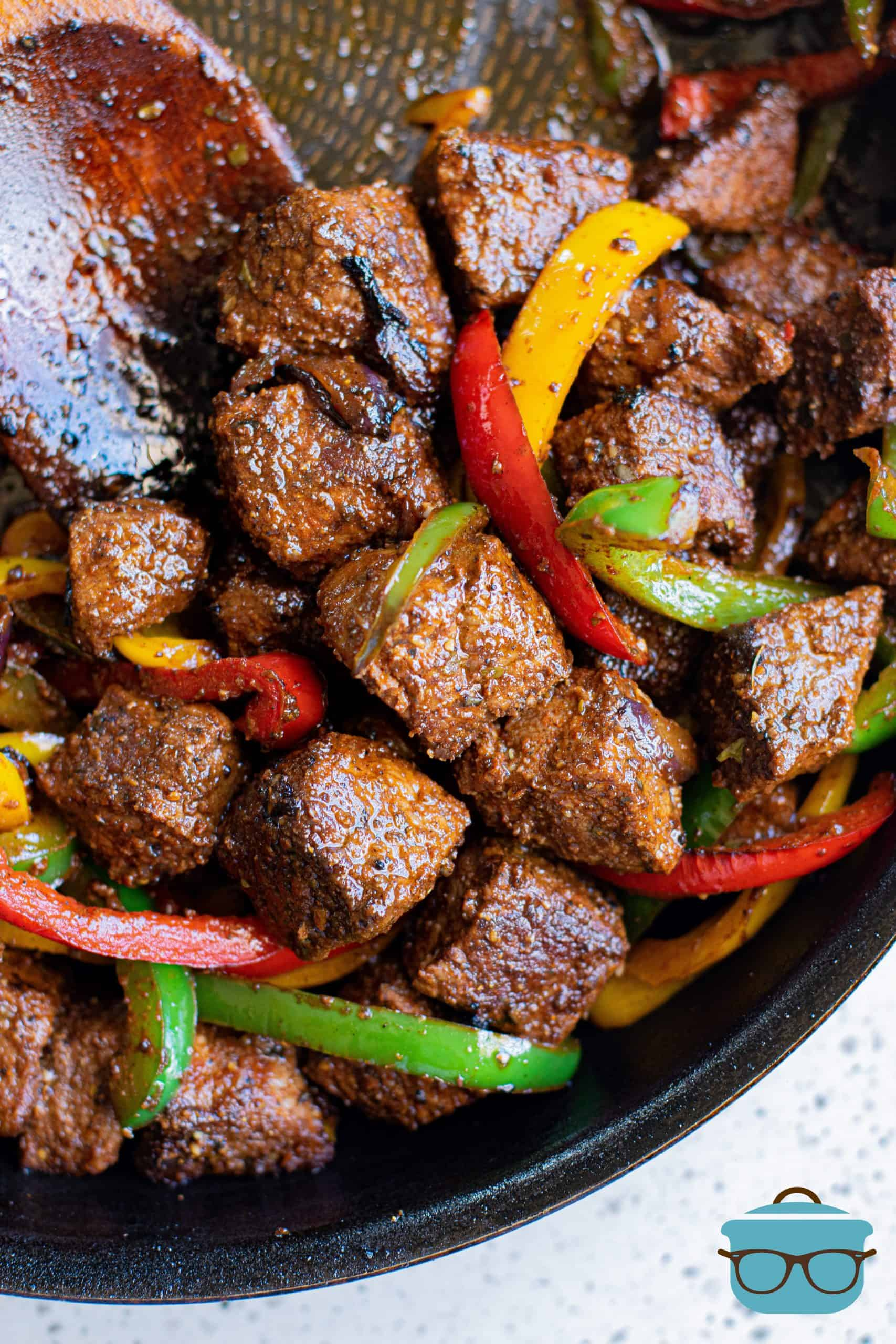 Finished Steak, onions and peppers in pan.