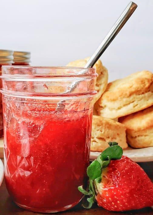 Strawberry Rhubarb Jam in jar with spoon