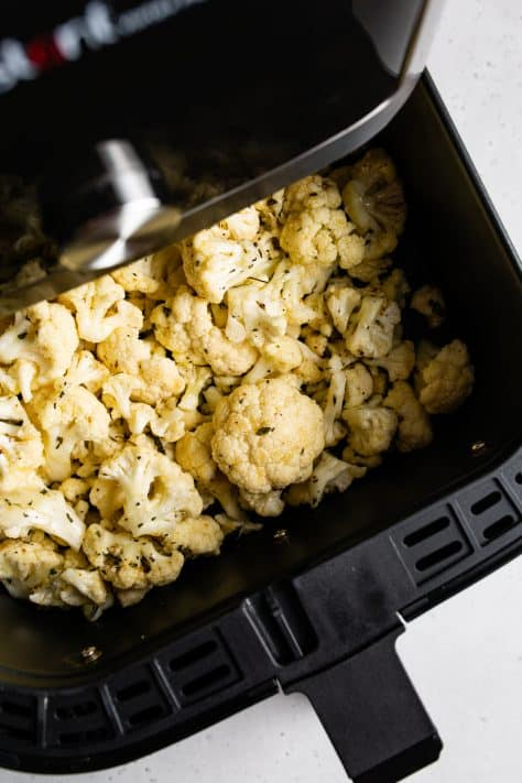 Cauliflower in air fryer basket