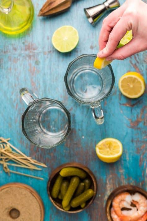 Lemon wetting tops of glasses