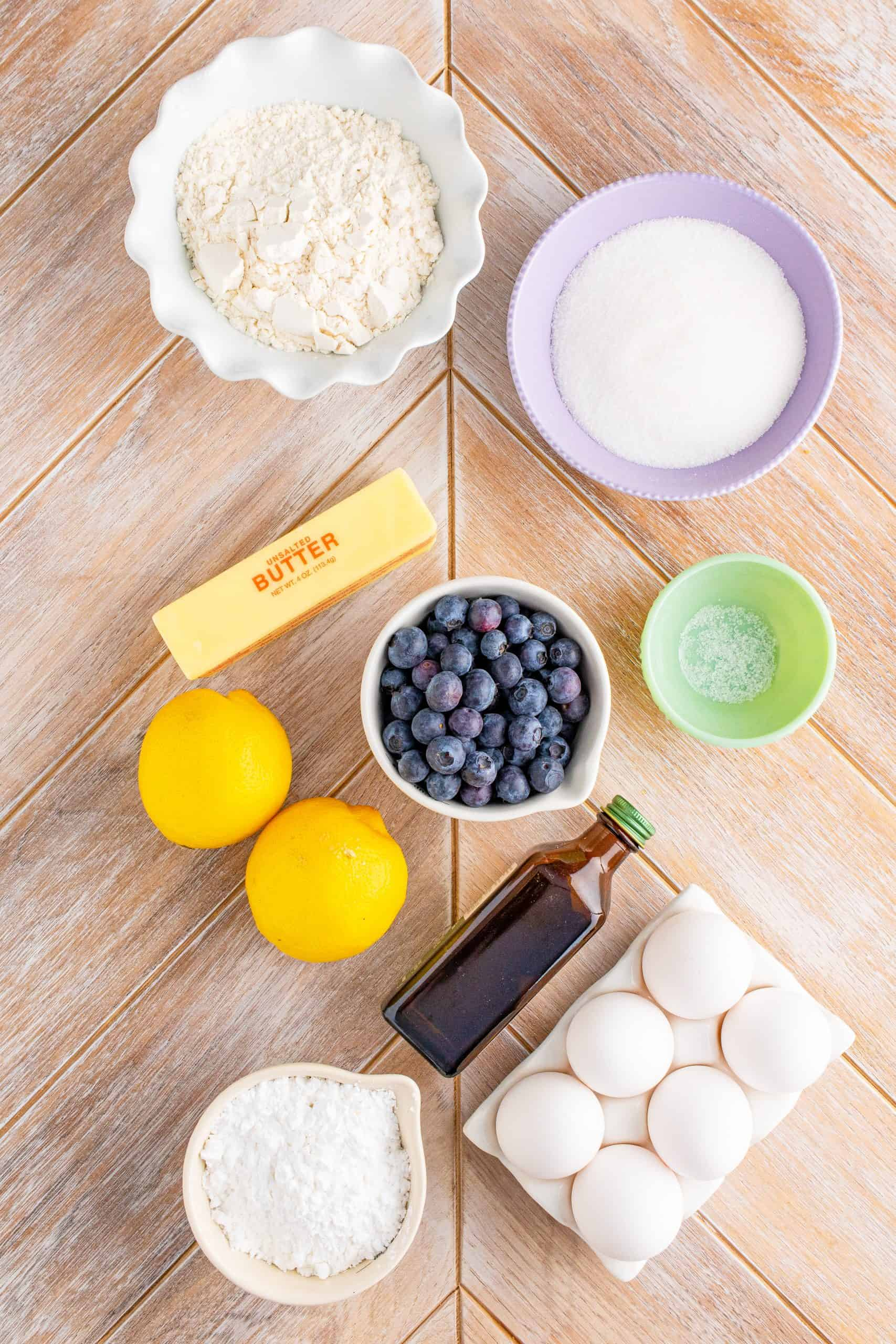 Ingredients needed: unsalted butter, granulated sugar, all-purpose flour, eggs, lemon zest, lemon juice, vanilla extract, blueberries and powdered sugar.