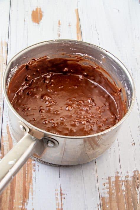 Frostig stirred together in metal sauce pan