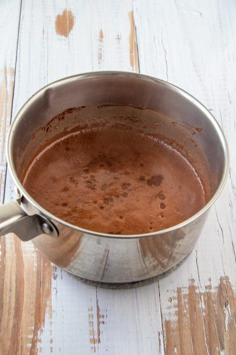 Melted butter, water and cocoa powder mixture in metal pan