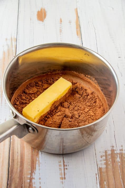 Margarine, milk and cocoa powder added to metal sauce pan