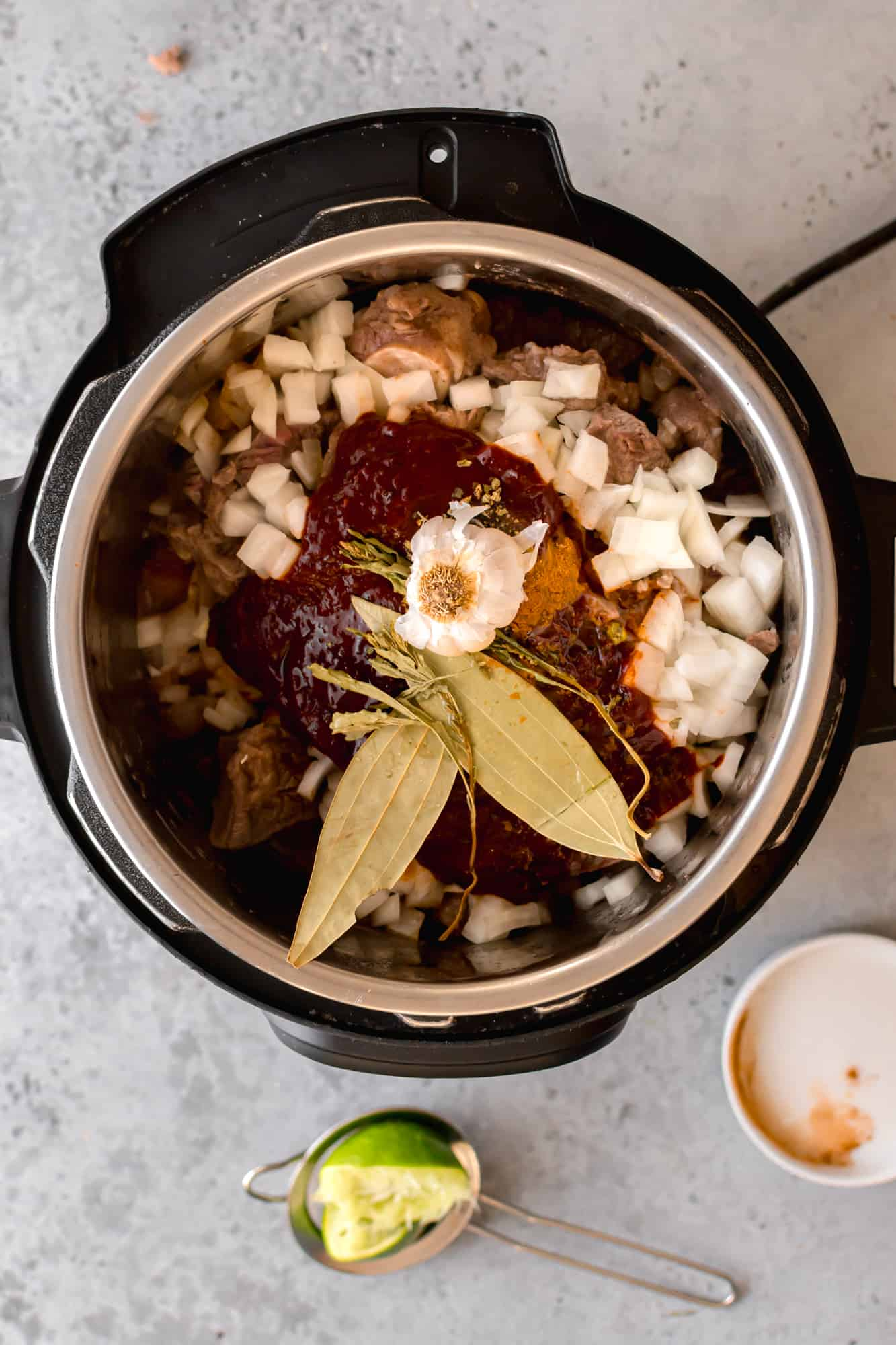 Garlic and beer added to the instant pot.