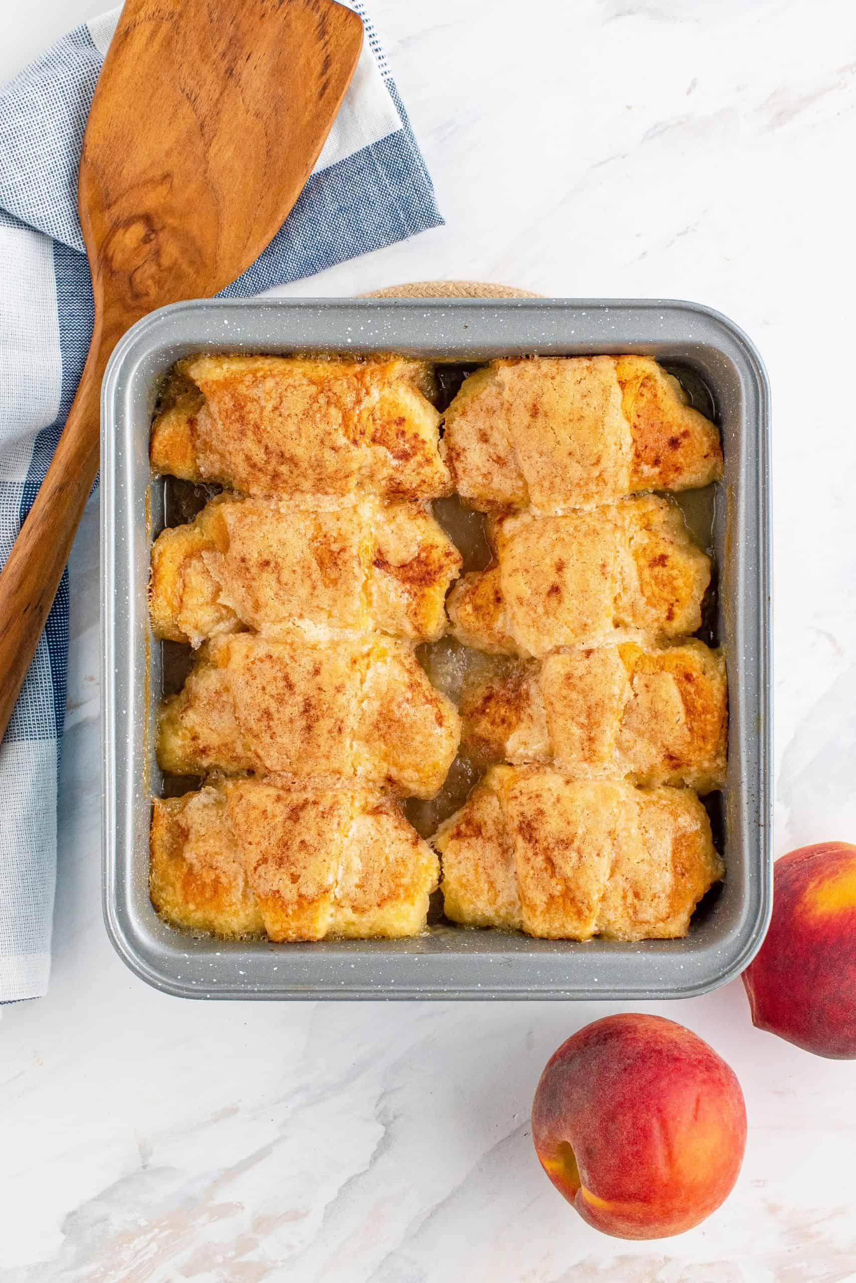 Finished Easy Fresh Peach Dumplings in pan.