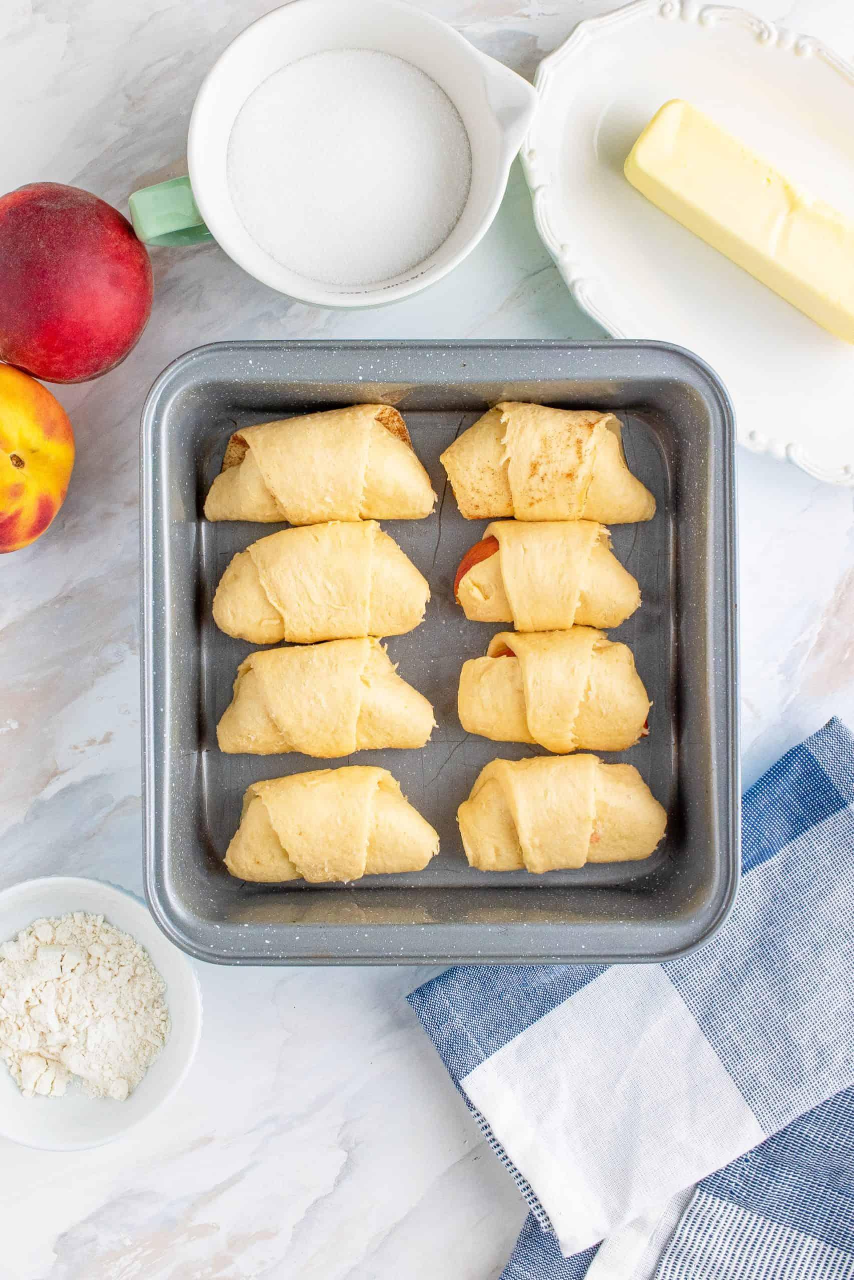 Peach Dumplings in pan.