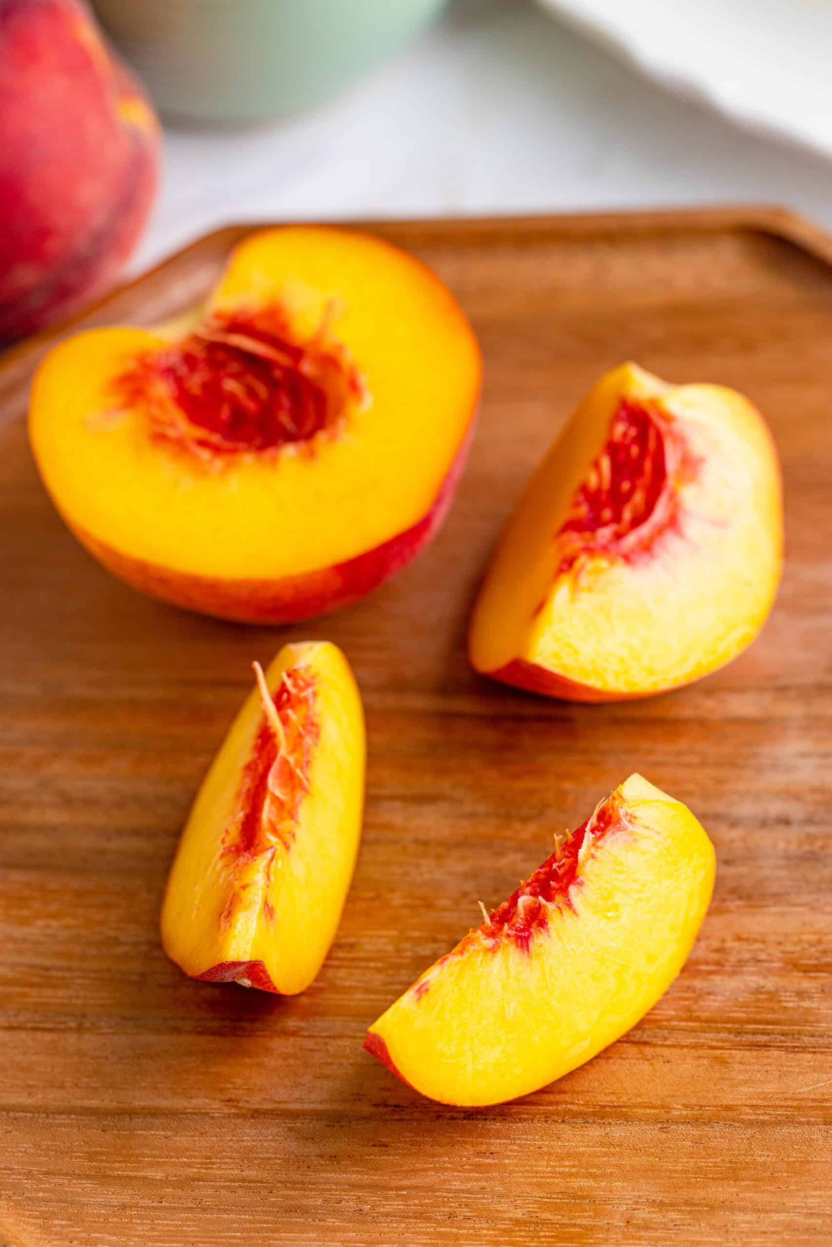 Peaches being sliced.
