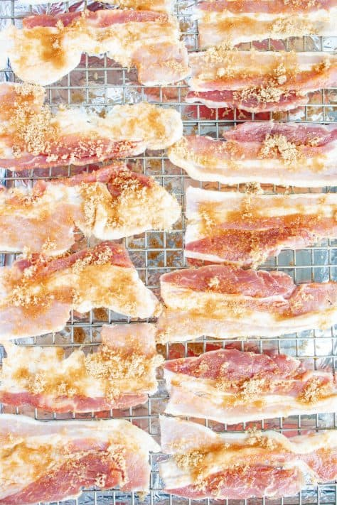 Cut bacon on wire rack over baking sheet sprinkled with brown sugar and pepper