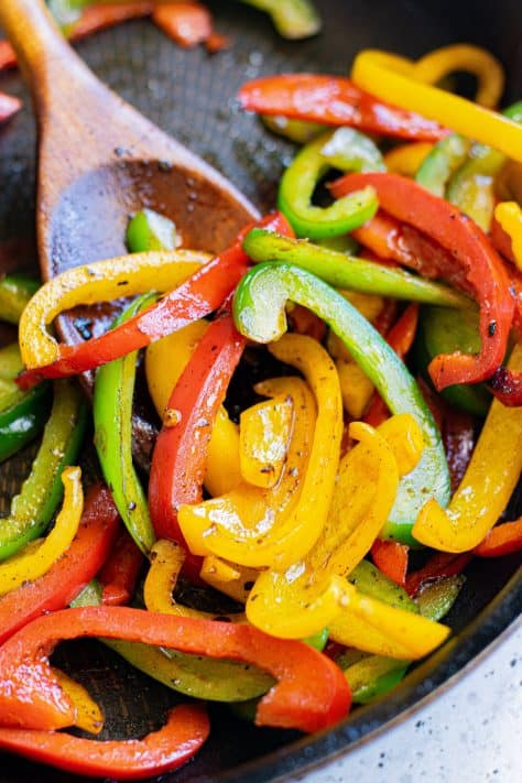 Peppers being cooked in pan