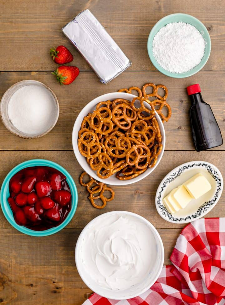 Ingredients needed: pretzels, sugar, salted butter, cream cheese, powdered sugar, almond extract, whipped topping and strawberry pie filling.
