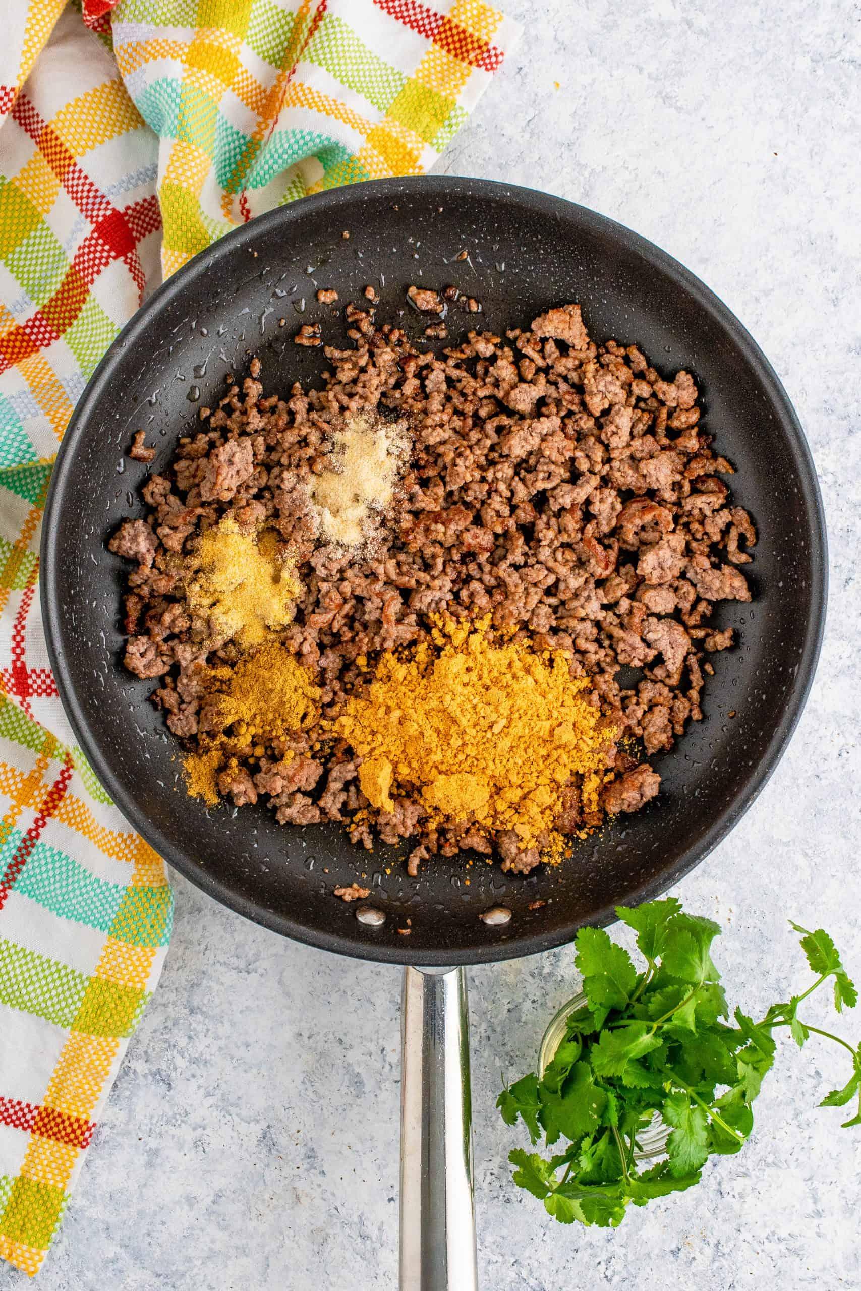 Taco seasoning, ground cumin, garlic powder and onion powder added to ground beef