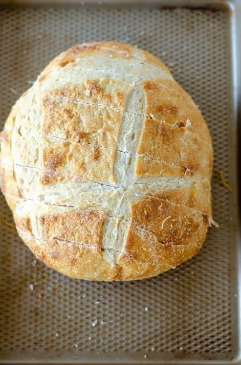 Bread on baking pan cut cross length